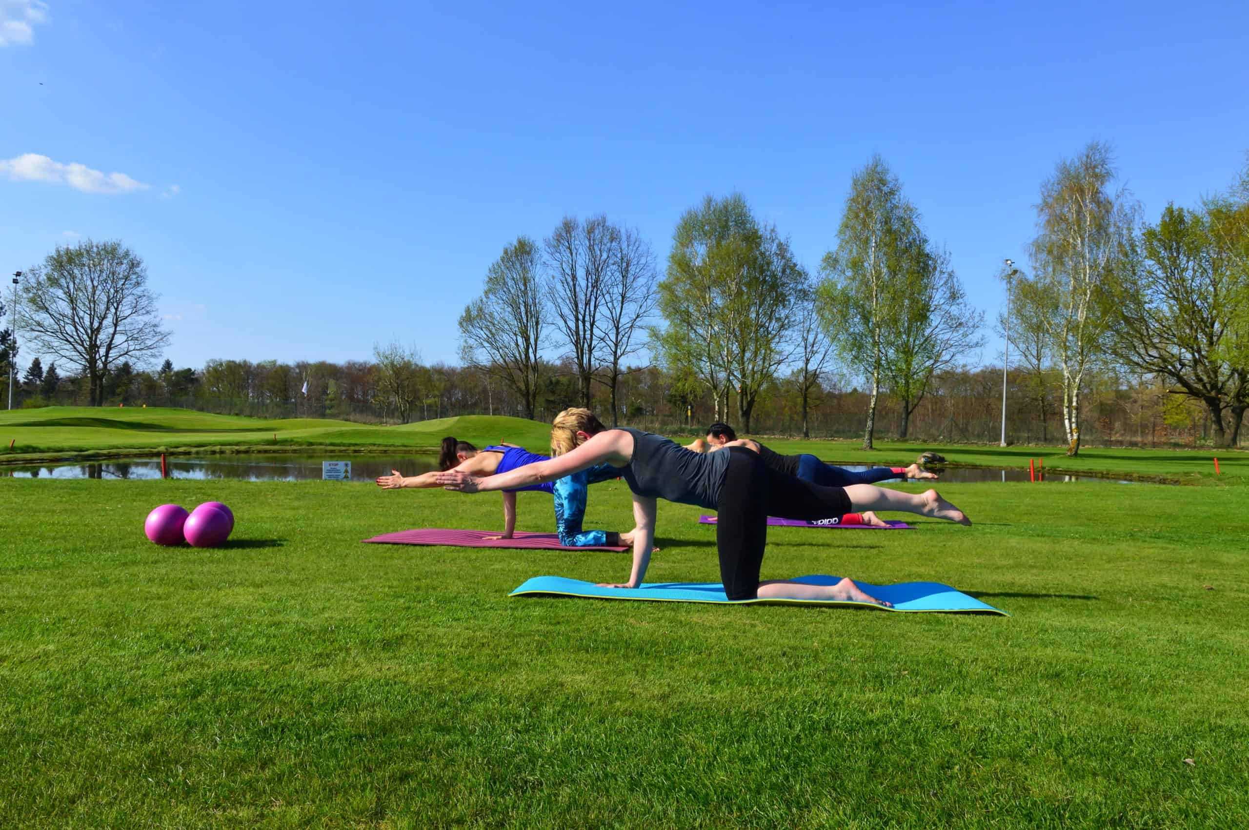 Group pilates in a park