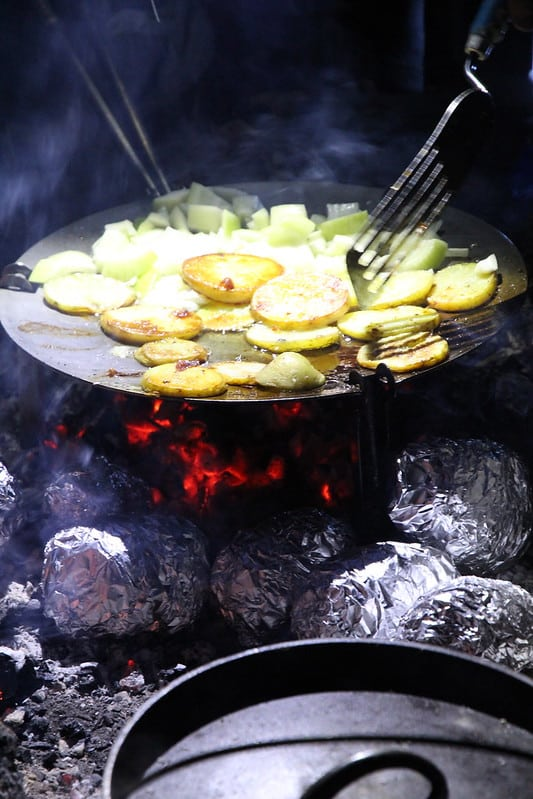 Vegetables cooking in campfire